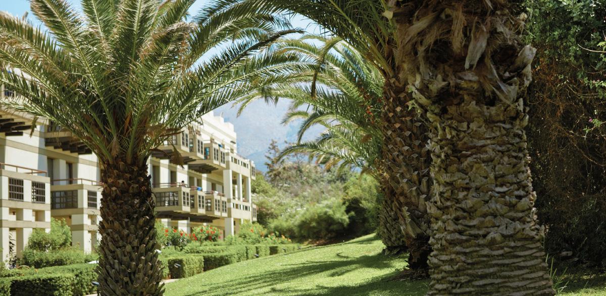 03-meli-palace-family-room-ground-floor-with-garden-view-crete-island